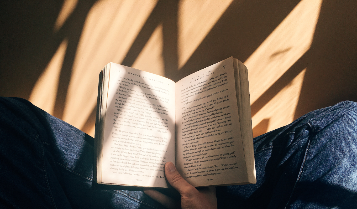 An image of a person reading a book